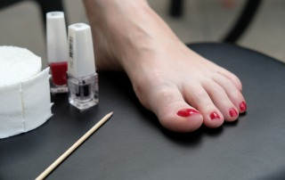 foot red nails pedicure